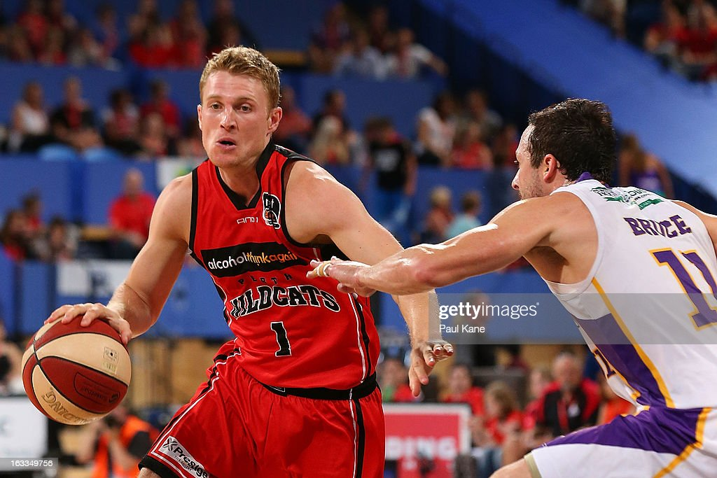 Rhys Carter of the Wildats looks to drive past Aaron Bruce of the Kings during the round 22 NBL match between the Perth Wildcats and the Sydney Kings at Perth Arena on March 8, 2013 in Perth, Australia.