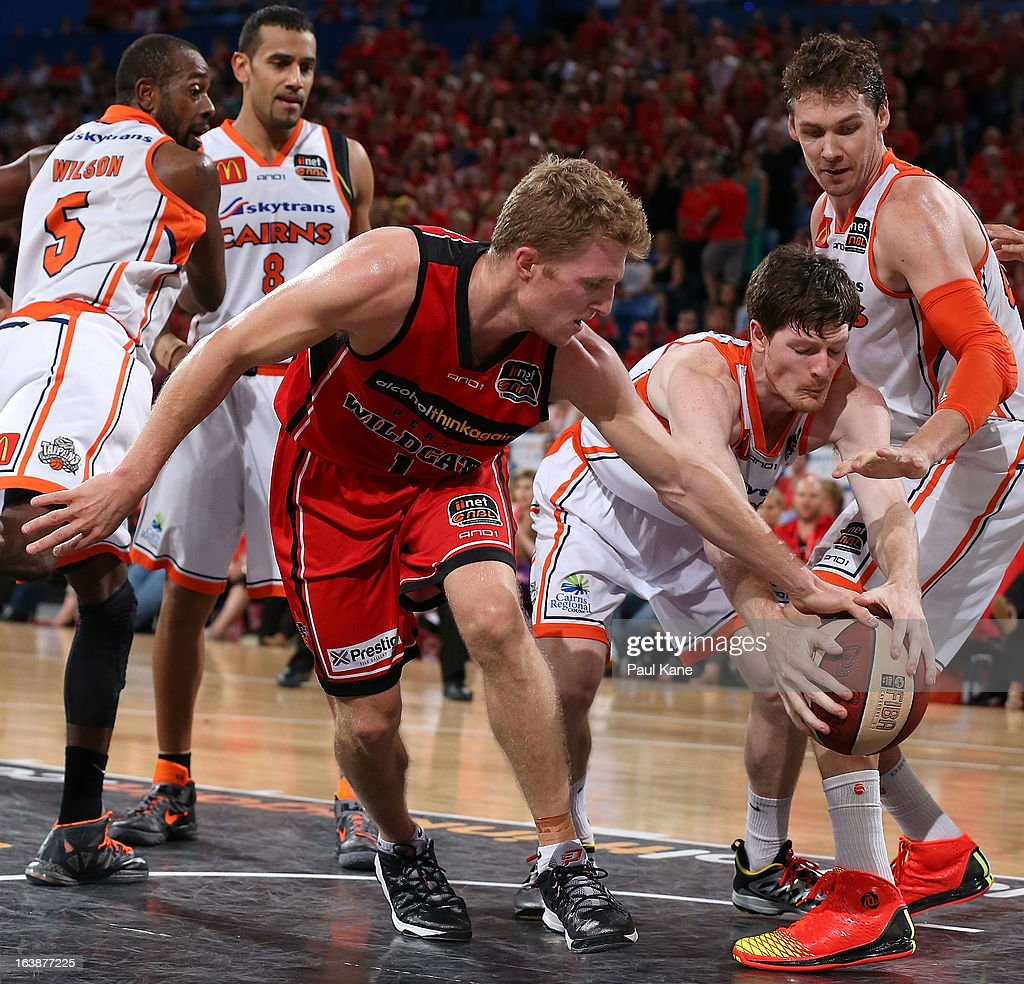 Rhys Carter of the Wildcats and Cameron Gliddon of the Taipans contest for the ball during the round 23 NBL match between the Perth Wildcats and the Cairns Taipans at Perth Arena on March 17, 2013 in Perth, Australia.