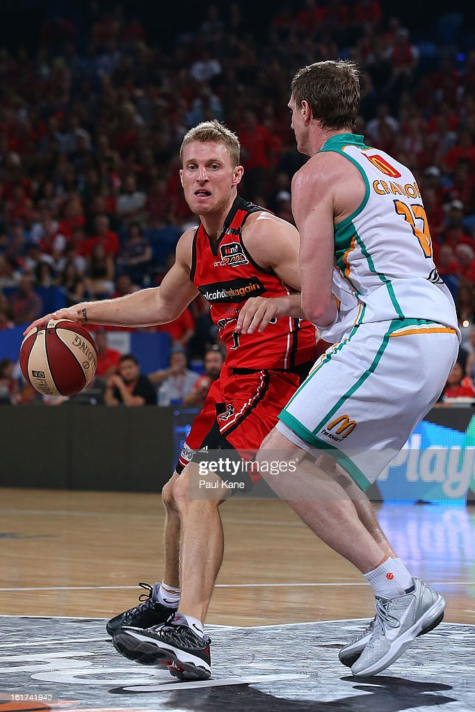 Rhys Carter of the Wildcats looks to layup against Peter Crawford of the Wildcats during the round 19 NBL match between the Perth Wildcats and the Townsville Crocodiles at Perth Arena on February 15, 2013 in Perth, Australia.