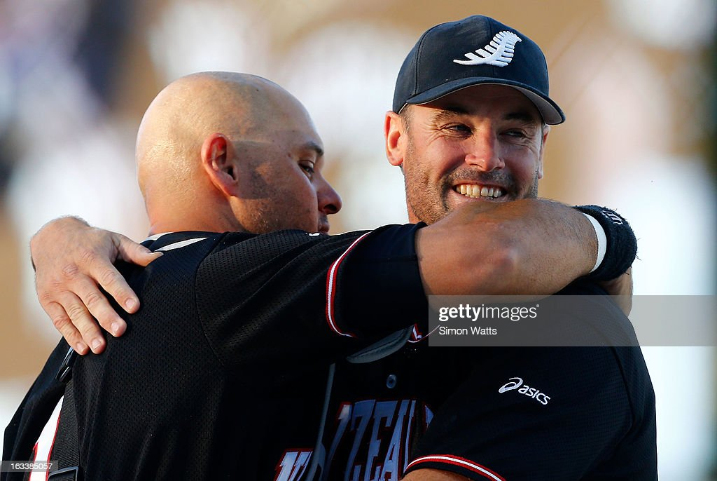 Rhys Casley of New Zealand is embraced by catcher Patrick Shannon after New Zealand beat Venezula to make the final during the playoff match between New Zealand and Venezuela at Tradstaff Sports Stadium on March 9, 2013 in Auckland, New Zealand.
