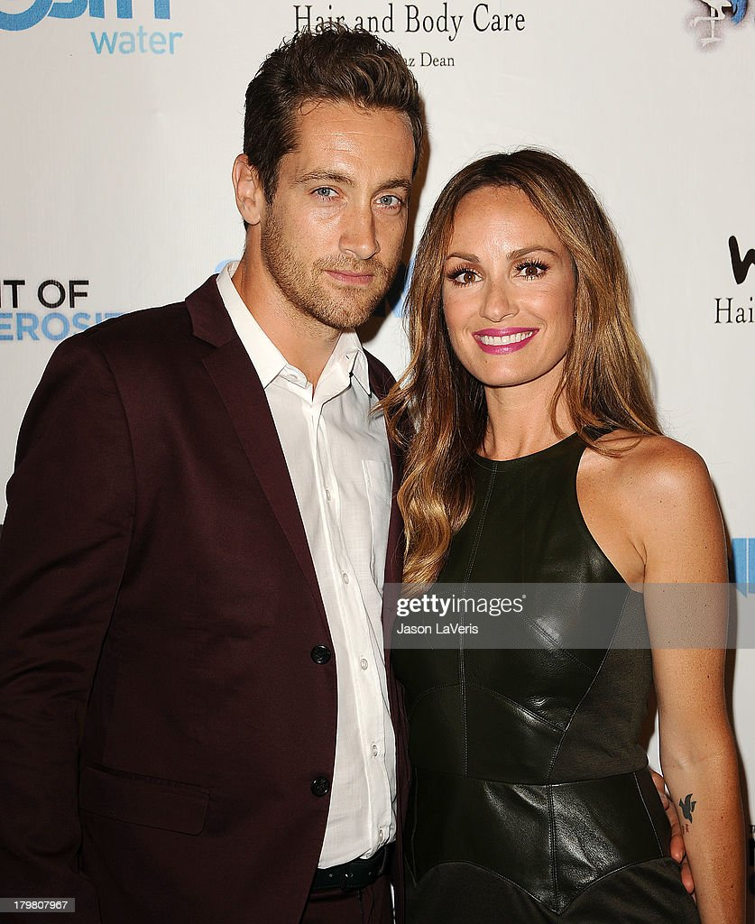 Rhys David Thomas and <a gi-track='captionPersonalityLinkClicked' href=/galleries/search?phrase=Catt+Sadler&family=editorial&specificpeople=754401 ng-click='$event.stopPropagation()'>Catt Sadler</a> attend Generosity Water's 5th annual Night of Generosity benefit at Beverly Hills Hotel on September 6, 2013 in Beverly Hills, California.