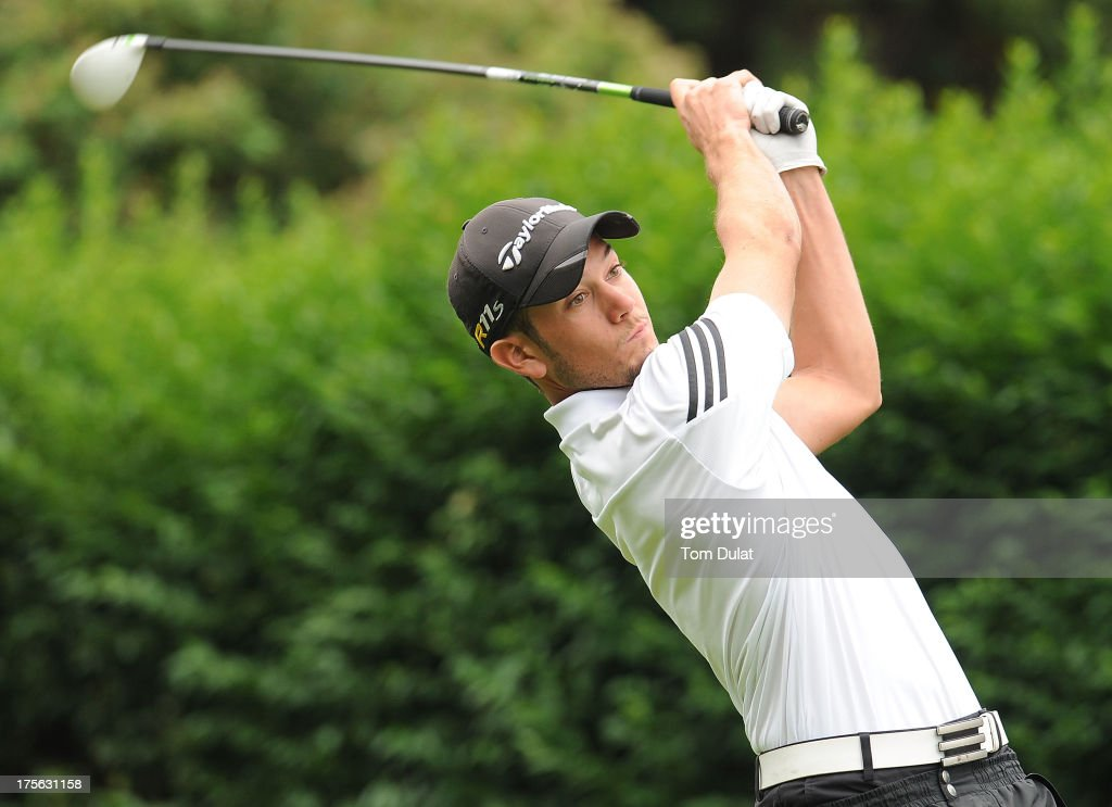 Rhys Davies of Cardiff Golf Club tees off from the 1st hole during the Golfbreaks.com PGA Fourball Regional Qualifier at Exeter Golf and Country Club on August 5, 2013 in Exeter, England.