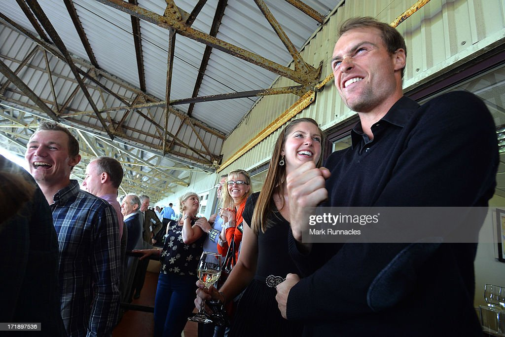 Rhys Davies of Wales (R) attends The Dubai Duty Free Irish Derby after the Third Round of the Irish Open at Carton House Golf Club on June 29, 2013 in Maynooth, Ireland.