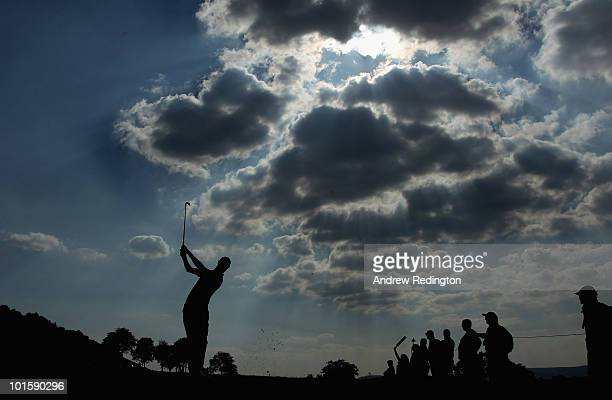Rhys Davies of Wales plays his second shot on the 16th hole during the first round of the Celtic Manor Wales Open on The Twenty Ten Course at The...