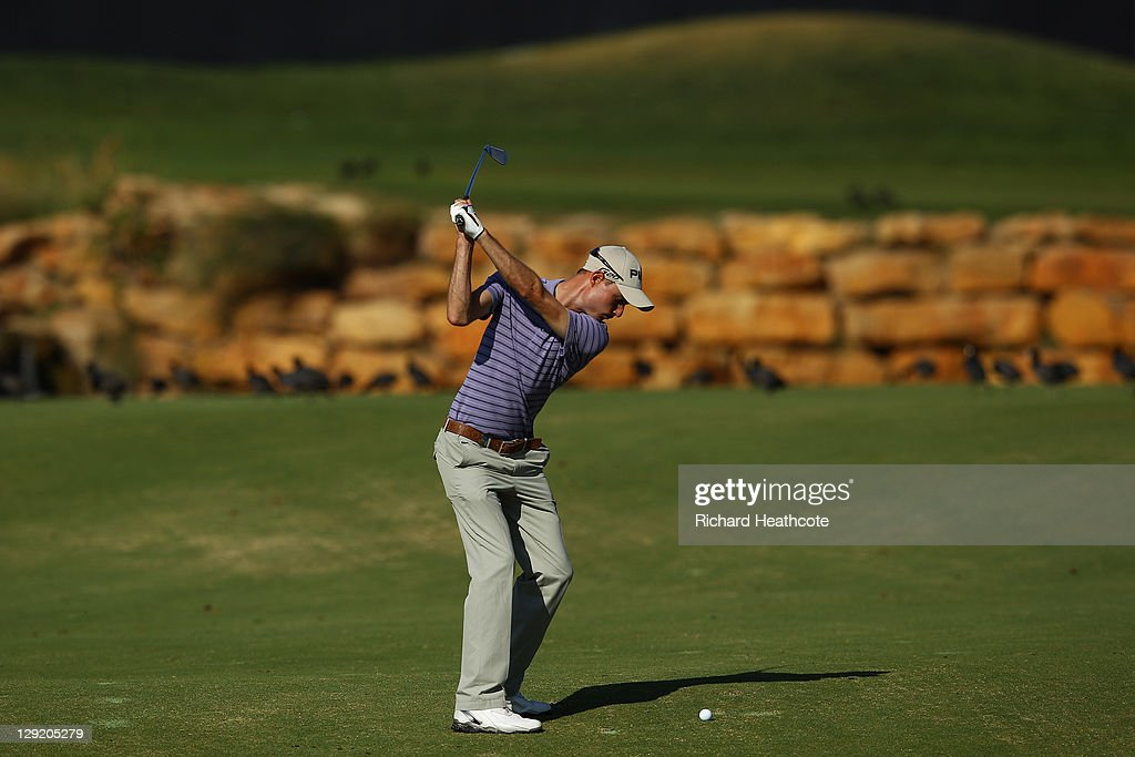 Rhys Davies of Wales plays into the 18th green during the second round the Portugal Masters at Oceanico Victoria Golf Course on October 14 2011 in...
