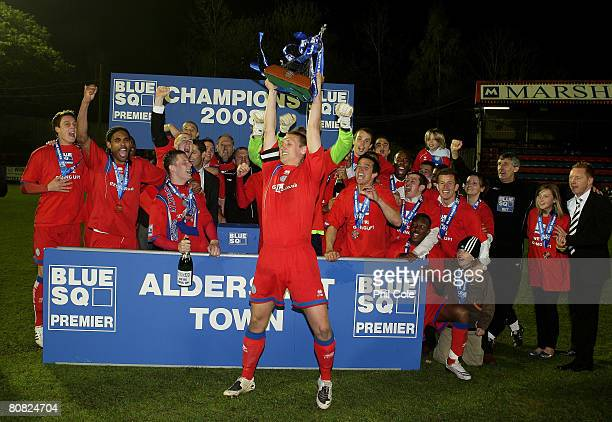 Rhys Day Captain of Aldershot Town picks up the Conferance trophy after the Blue Square Premier match between Aldershot Town and Weymouth at the...