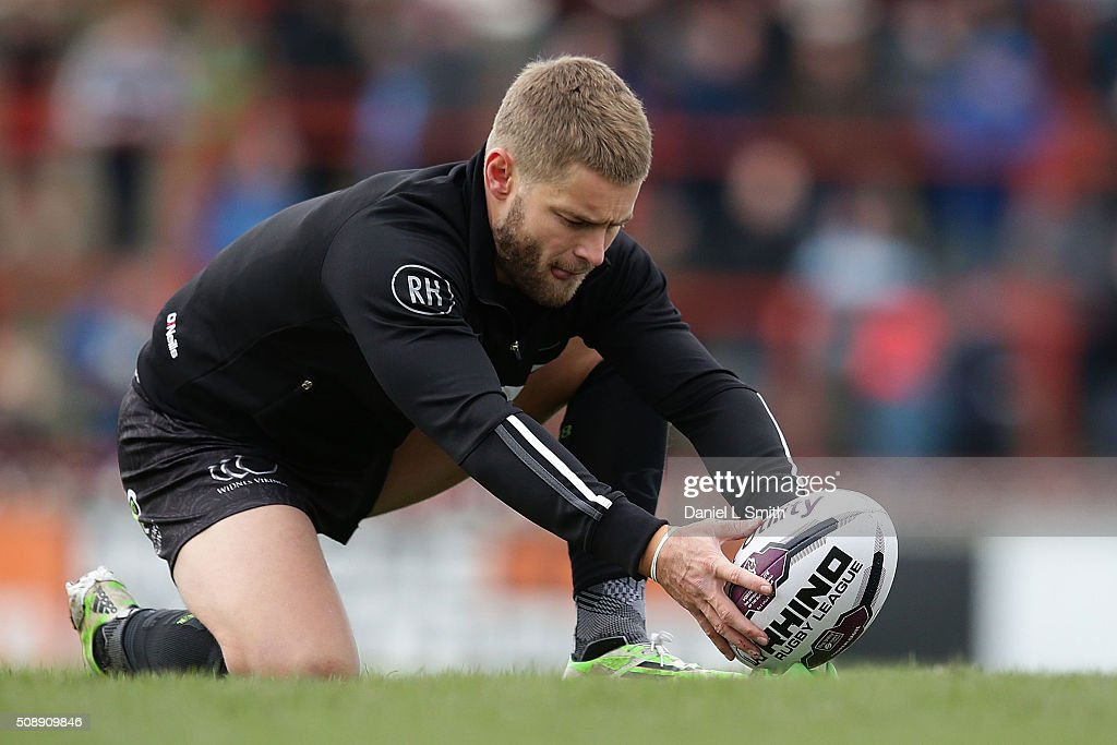 Rhys Hanbury of Widnes Vikings prepares the ball during warm up prior to kick off in the First Utility Super League Round One match between Wakefield Wildcats and Widnes Vikings at The Rapid Solicitors Stadium on February 7, 2016 in Wakefield, England.