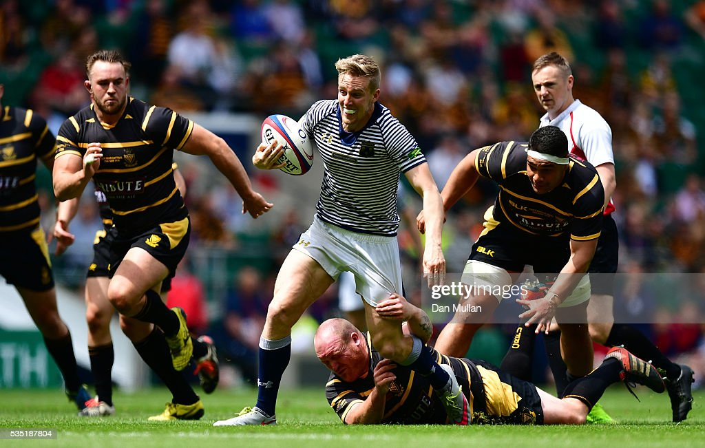 Rhys Hayes of Cheshire skips through the tackle of Craig Williams of Cornwall during the 2016 Bill Beaumont Cup Final between Cornwall and Cheshire at Twickenham Stadium on May 29, 2016 in London, England.