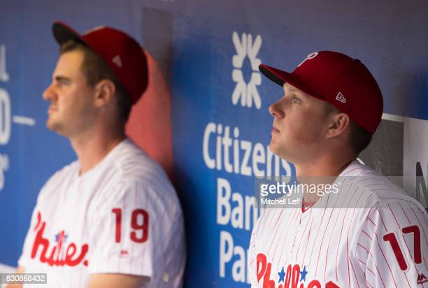 Rhys Hoskins of the Philadelphia Phillies and Tommy Joseph sit in the dugout prior to the game against the New York Mets at Citizens Bank Park on...