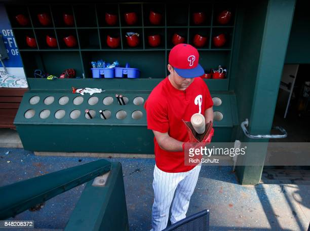 Rhys Hoskins of the Philadelphia Phillies applies pine tar to his bat during batting practice before a game against the Oakland Athletics at Citizens...