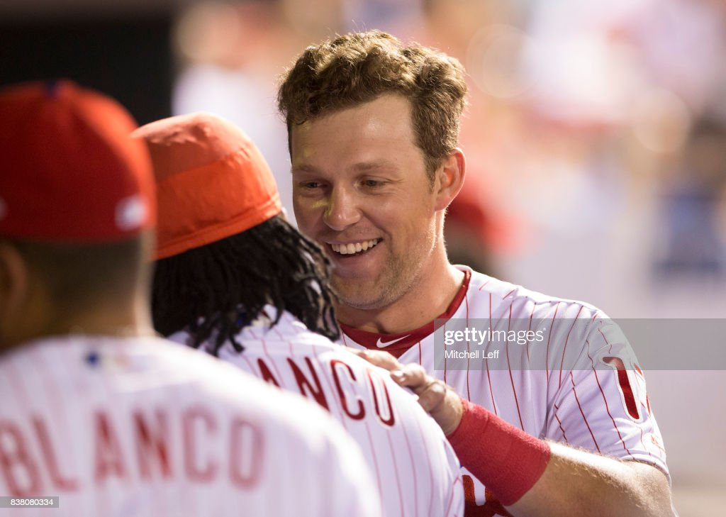 Rhys Hoskins #17 of the Philadelphia Phillies celebrates in the dugout with Maikel Franco #7 in the bottom of the third inning against the Miami Marlins at Citizens Bank Park on August 23, 2017 in Philadelphia, Pennsylvania. The Phillies defeated the Marlins 8-0.