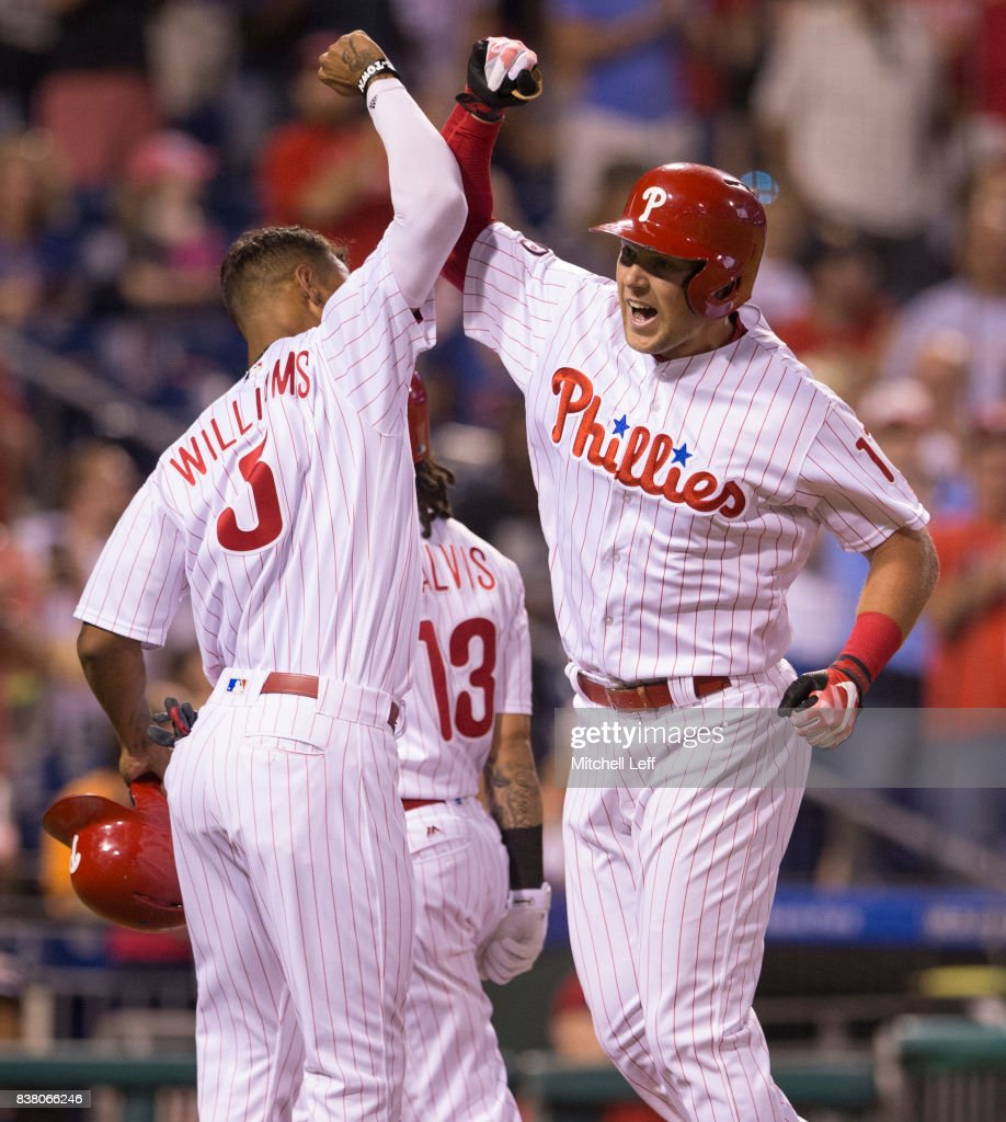 Rhys Hoskins #17 of the Philadelphia Phillies celebrates with Nick Williams #5 and Freddy Galvis #13 after hitting a three run home run in the bottom of the third inning against the Miami Marlins at Citizens Bank Park on August 23, 2017 in Philadelphia, Pennsylvania.