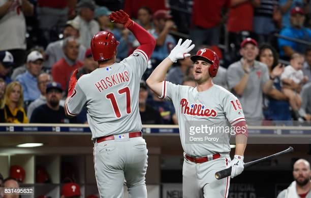 Rhys Hoskins of the Philadelphia Phillies is congratulated by Tommy Joseph after hitting a solo home run during the seventh inning of a baseball game...