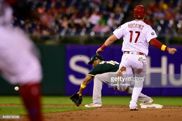 Rhys Hoskins of the Philadelphia Phillies is safe at second base as Marcus Semien of the Oakland Athletics can't lay down the tag at Citizens Bank...