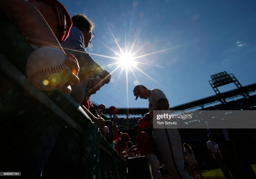 Rhys Hoskins #17 of the Philadelphia Phillies signs autographs before the start of a game against the New York Mets at Citizens Bank Park on October 1, 2017 in Philadelphia, Pennsylvania.