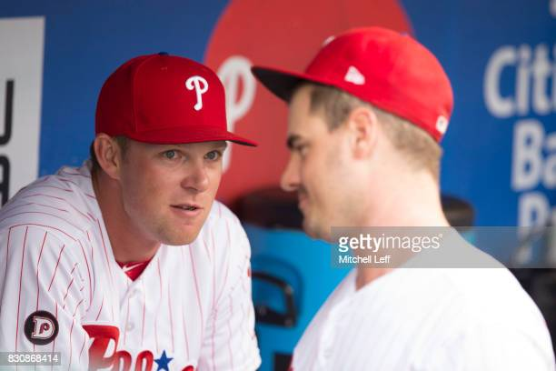 Rhys Hoskins of the Philadelphia Phillies talks to Tommy Joseph in the dugout prior to the game against the New York Mets at Citizens Bank Park on...