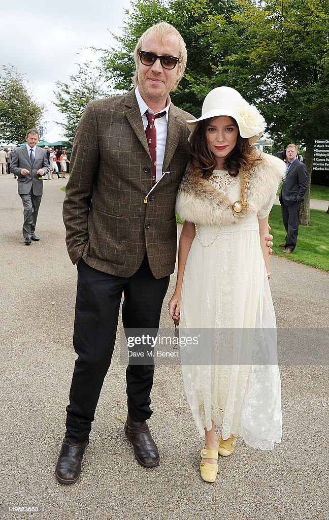 Rhys Ifans (L) and Anna Friel attend Ladies Day at Glorious Goodwood held at Goodwood Racecourse on August 2, 2012 in Chichester, England.