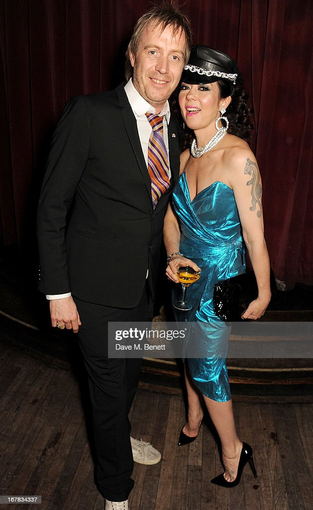 Rhys Ifans (L) and Katy England attend Fran Cutler's surprise birthday party supported by ABSOLUT Elyx at The Box Soho on April 30, 2013 in London, England.