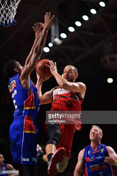 Rhys Martin of the Illawarra Hawks drives to the basket over Terrance Ferguson of the Adelaide 36ers during game three of the NBL Semi Final series...