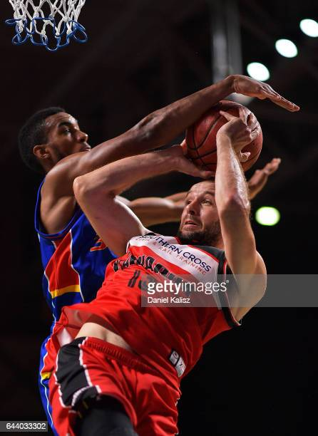 Rhys Martin of the Illawarra Hawks shoots over Terrance Ferguson of the Adelaide 36ers during game three of the NBL Semi Final series between the...
