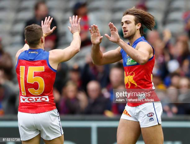 Rhys Mathieson of the Lions celebrates a goal with Dayne Zorko of the Lions during the 2017 AFL round 17 match between the Richmond Tigers and the...