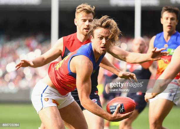 Rhys Mathieson of the Lions looks to pass the ball during the round 22 AFL match between the Melbourne Demons and the Brisbane Lions at Melbourne...