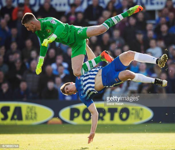 Rhys Oates of Hartlepool gets taken down by Ian Lawlor of Doncaster Rovers during the Sky Bet League Two match between Hartlepool and Doncaster at...