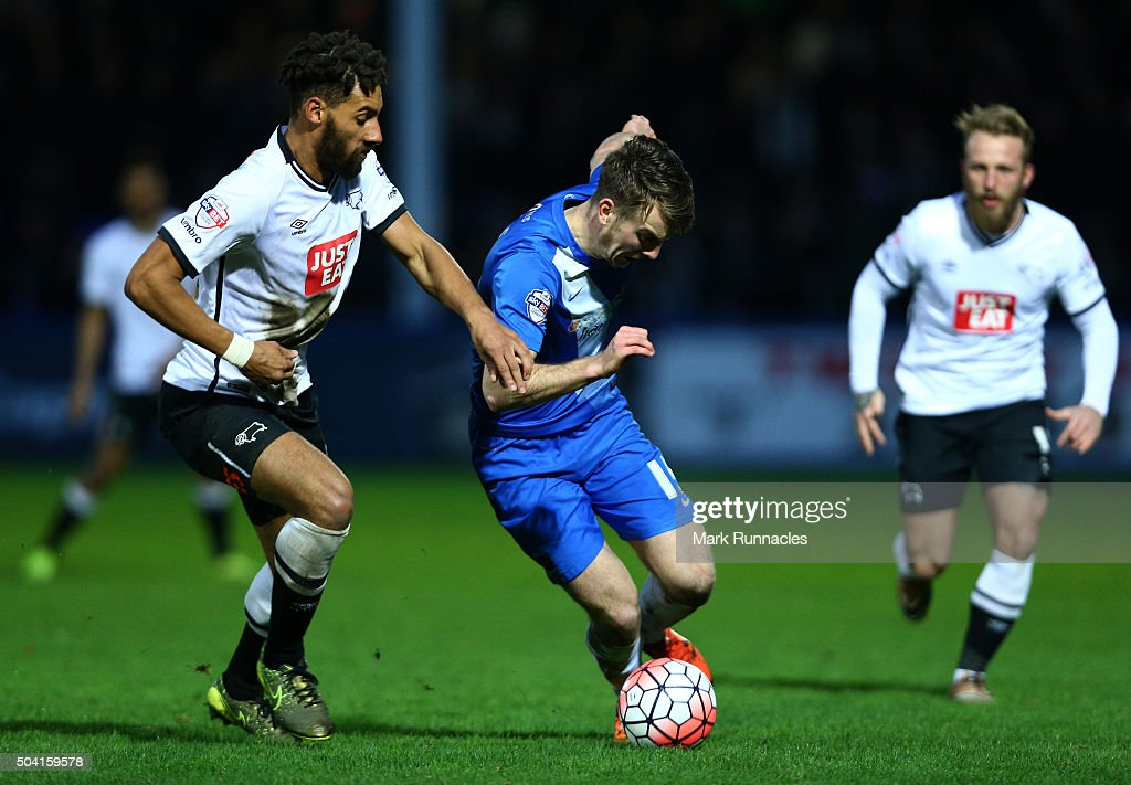Rhys Oates of Hartlepool United takes on Nick Blackman of Derby County during The Emirates FA Cup third round match between Hartlepool United FC and Derby County FC at Victoria Park on January 9, 2016 in Hartlepool, England.