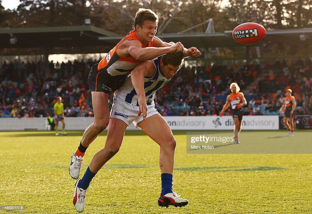 Rhys Palmer of the Giants and <a gi-track='captionPersonalityLinkClicked' href=/galleries/search?phrase=Nick+Dal+Santo&family=editorial&specificpeople=213937 ng-click='$event.stopPropagation()'>Nick Dal Santo</a> of the Kangaroos contest possession during the round 20 AFL match between the Greater Western Sydney Giants and the North Melbourne Kangaroos at Stratrack Oval on August 9, 2014 in Canberra, Australia.