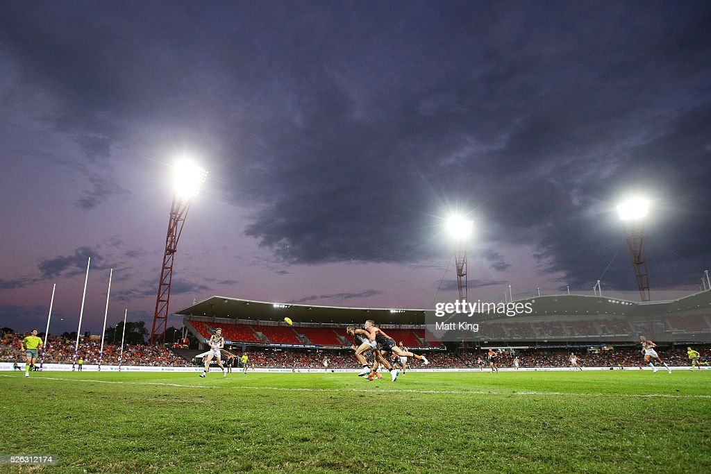 Rhys Palmer of the Giants competes for the ball against Josh Gibson of the Hawks during the round six AFL match between the Greater Western Sydney Giants and the Hawthorn Hawks at Spotless Stadium on April 30, 2016 in Sydney, Australia.