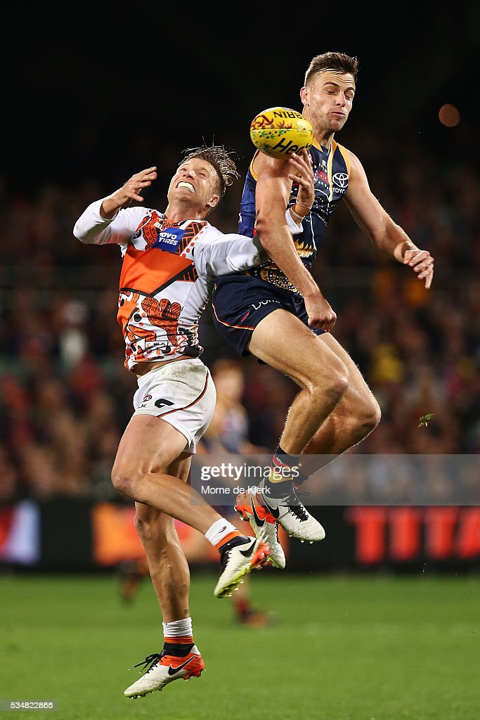 Rhys Palmer of the Giants competes in the air with Brodie Smith of the Crows during the round 10 AFL match between the Adelaide Crows and the Greater Western Sydney Giants at Adelaide Oval on May 28, 2016 in Adelaide, Australia.