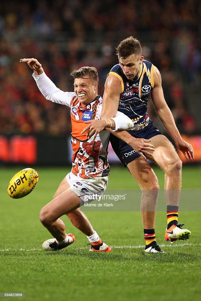 Rhys Palmer of the Giants competes with Brodie Smith of the Crows during the round 10 AFL match between the Adelaide Crows and the Greater Western Sydney Giants at Adelaide Oval on May 28, 2016 in Adelaide, Australia.