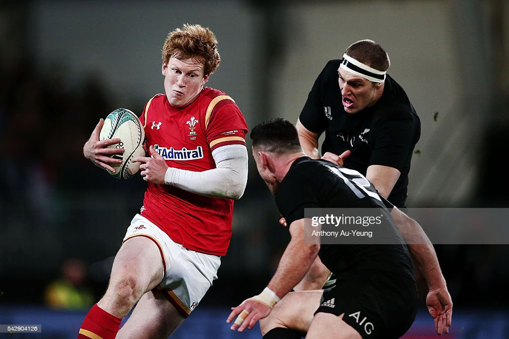 Rhys Patchell of Wales makes a run at <a gi-track='captionPersonalityLinkClicked' href=/galleries/search?phrase=Ryan+Crotty&family=editorial&specificpeople=4252951 ng-click='$event.stopPropagation()'>Ryan Crotty</a> of New Zealand during the International Test match between the New Zealand All Blacks and Wales at Forsyth Barr Stadium on June 25, 2016 in Dunedin, New Zealand.