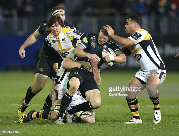 Rhys Priestland of Bath is tackled by George Smith during the European Rugby Champions Cup match between Bath and Wasps at the Recreation Ground on...