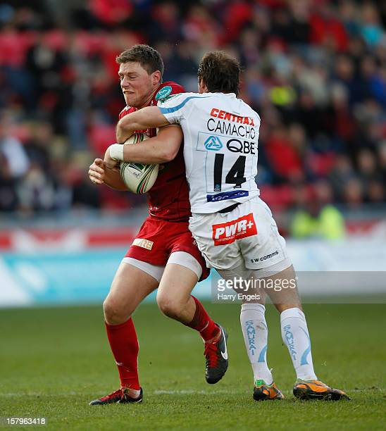 Rhys Priestland of Scarlets is tackled by Gonzalo Camacho of Exeter during the Heineken Cup match between Scarlets and Exeter Chiefs at Parc y...