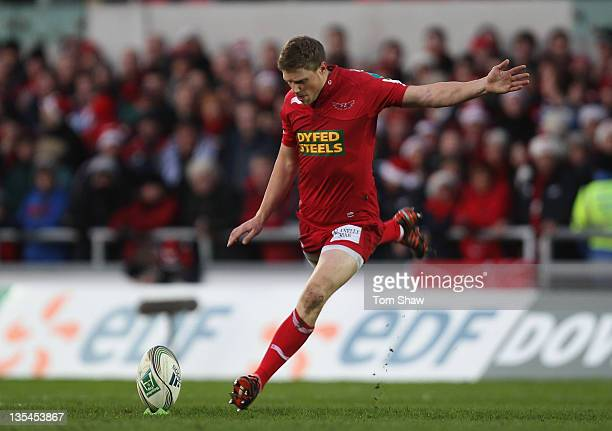 Rhys Priestland of Scarlets kicks a penalty during the Heineken Cup match between Scarlets and Munster at Parc y Scarlets on December 10 2011 in...