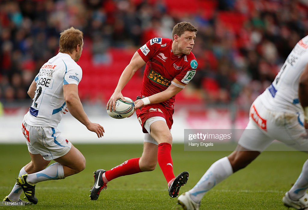 <a gi-track='captionPersonalityLinkClicked' href=/galleries/search?phrase=Rhys+Priestland&family=editorial&specificpeople=4195648 ng-click='$event.stopPropagation()'>Rhys Priestland</a> of Scarlets passes the ball during the Heineken Cup match between Scarlets and Exeter Chiefs at Parc y Scarlets on December 8, 2012 in Llanelli, Wales.