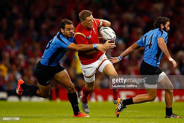 Rhys Priestland of Wales is tackled by Joaquin Prada of Uruguay during the 2015 Rugby World Cup Pool A match between Wales and Uruguay at the...