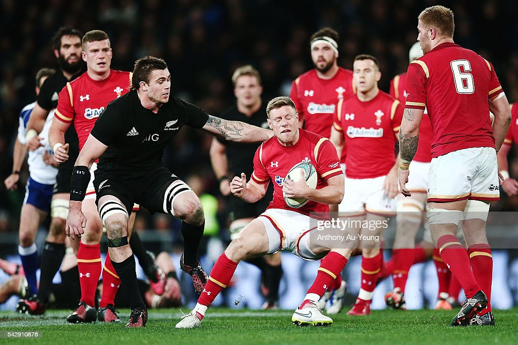 <a gi-track='captionPersonalityLinkClicked' href=/galleries/search?phrase=Rhys+Priestland&family=editorial&specificpeople=4195648 ng-click='$event.stopPropagation()'>Rhys Priestland</a> of Wales is tackled by Liam Squire of New Zealand during the International Test match between the New Zealand All Blacks and Wales at Forsyth Barr Stadium on June 25, 2016 in Dunedin, New Zealand.