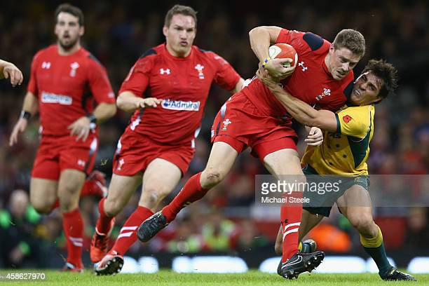 Rhys Priestland of Wales is tackled by Nick Phipps of Australia during the International match between Wales and Australia at the Millennium Stadium...