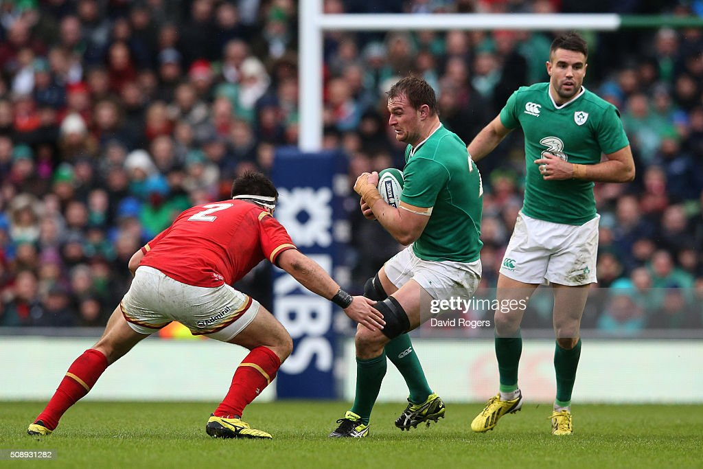 Rhys Ruddock of Ireland is tackled by Scott Baldwin of Wales during the RBS Six Nations match between Ireland and Wales at the Aviva Stadium on February 7, 2016 in Dublin, Ireland.