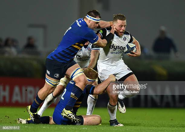 Rhys Ruddock of Leinster tackles Max Lahiff of Bath during the European Champions cup Pool 5 rugby game at the RDS arena on January 16 2016 in Dublin...