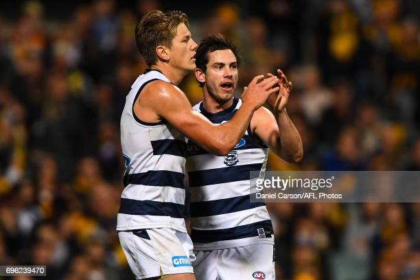 Rhys Stanley and Daniel Menzel of the Cats celebrates a goal during the 2017 AFL round 13 match between the West Coast Eagles and the Geelong Cats at...