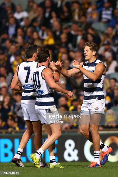 Rhys Stanley of the Cats celebrates a goal with Harry Taylor and Daniel Menzel during the round 13 AFL match between the West Coast Eagles and the...