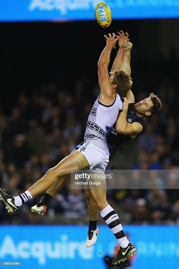 Rhys Stanley of the Cats (L) competes for the ball against Matthew Wright of the Blues during the round 10 AFL match between the Carlton Blues and the Geelong Cats at Etihad Stadium on May 29, 2016 in Melbourne, Australia.