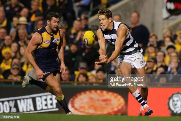 Rhys Stanley of the Cats handpasses the ball during the round 13 AFL match between the West Coast Eagles and the Geelong Cats at Domain Stadium on...
