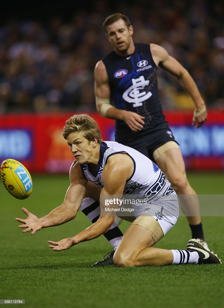 Rhys Stanley of the Cats marks the ball against Sam Docherty of the Blues during the round 10 AFL match between the Carlton Blues and the Geelong Cats at Etihad Stadium on May 29, 2016 in Melbourne, Australia.