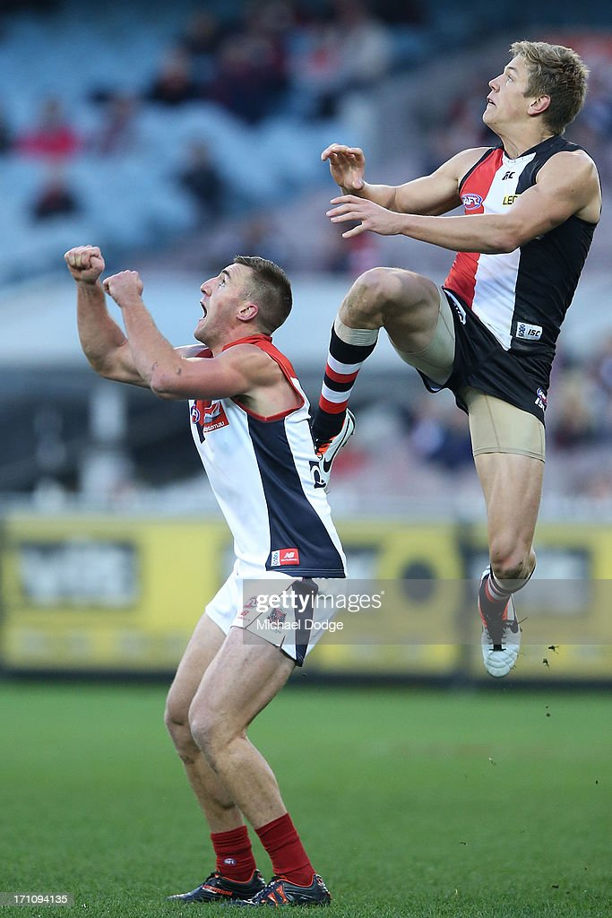 Rhys Stanley of the Saints jumps for the ball over Lynden Dunn of the Demons during the round 13 AFL match between the St Kilda Saints and the Melbourne Demons at Melbourne Cricket Ground on June 22, 2013 in Melbourne, Australia.