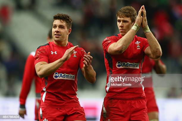 Rhys Webb and Liam Williams of Wales applaud the travelling support after their sides 2013 victory during the RBS Six Nations match between France...