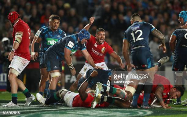 Rhys Webb of the British Irish Lions celebrates as teammate CJ Stander of the British Irish Lions is driven over for their team's opening try during...